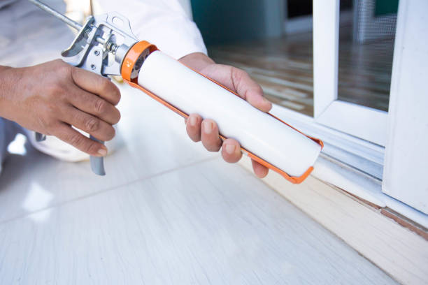 Construction workers install doors - windows and use silicon and sealant. Construction workers install doors - windows and use silicon and sealant. silicon stock pictures, royalty-free photos & images