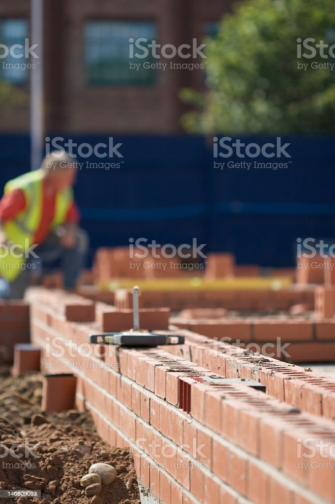 Construction workers laying brick royalty-free stock photo