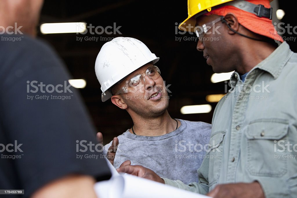 Construction workers looking at plans royalty-free stock photo