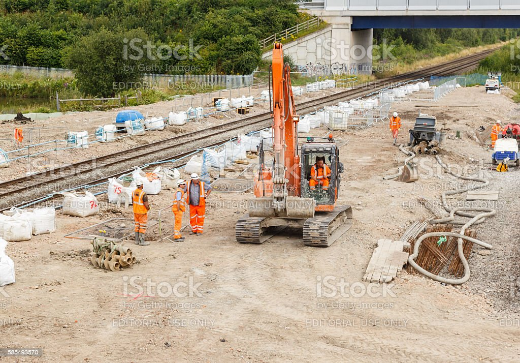 Construction workers next to a section of railway track stock photo
