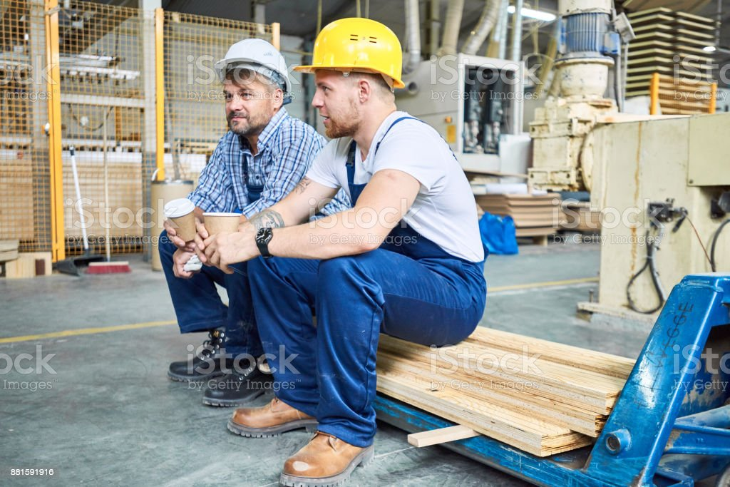 Construction Workers on Coffee Break stock photo