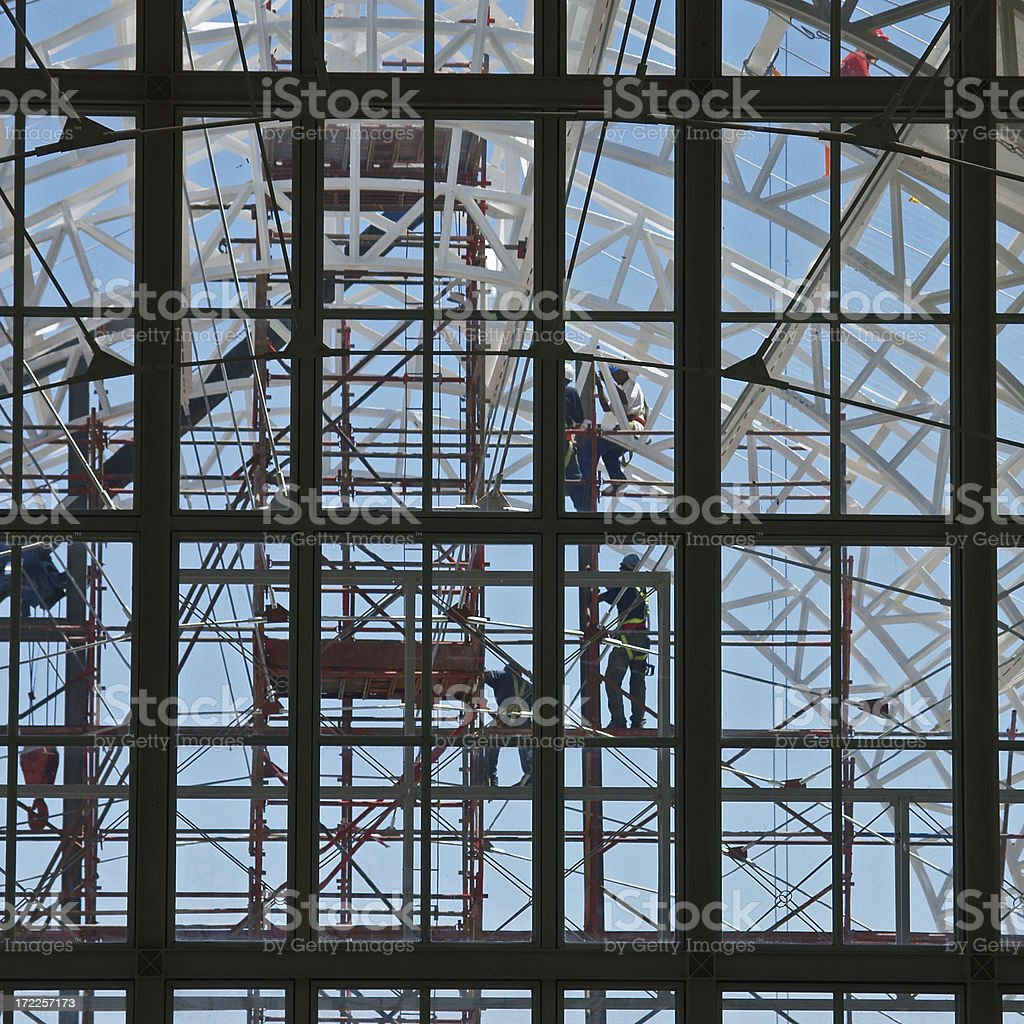 Construction workers on steel framed building royalty-free stock photo