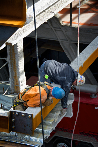 New York City, USA - October 28, 2014: A team of welders inspecting girders on a skyscraper under construction at Hudson Yards, West Side of Manhattan.