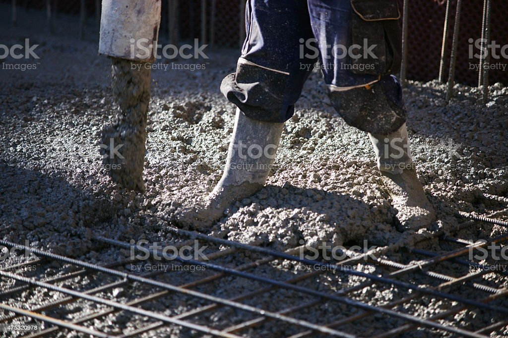 Construction workers pumping stock photo