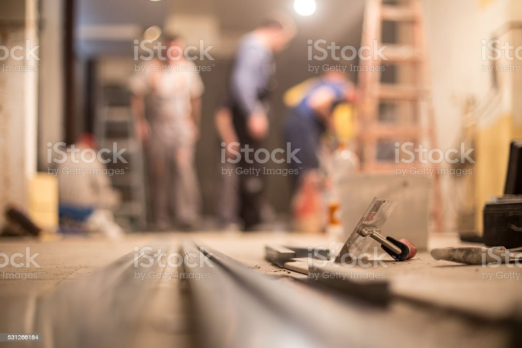 construction workers renovating interior stock photo