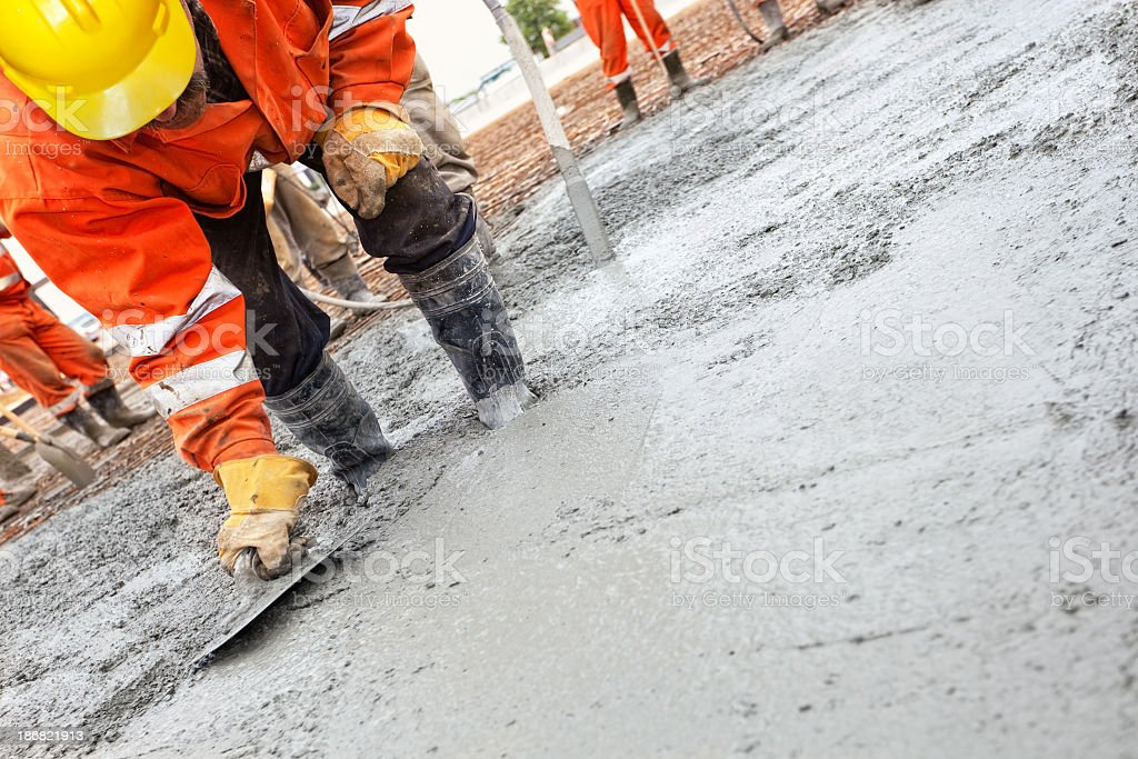 Construction workers smooth the concrete stock photo