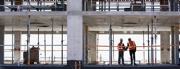 Construction workers standing together on construction site stock photo