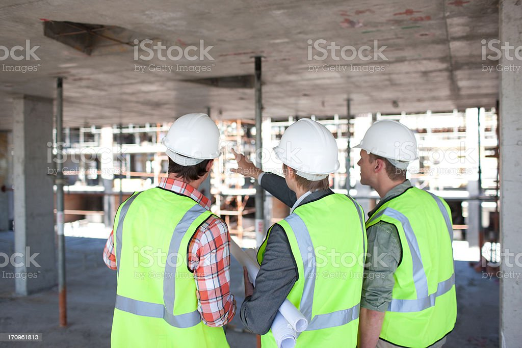 Construction workers talking on construction site royalty-free stock photo