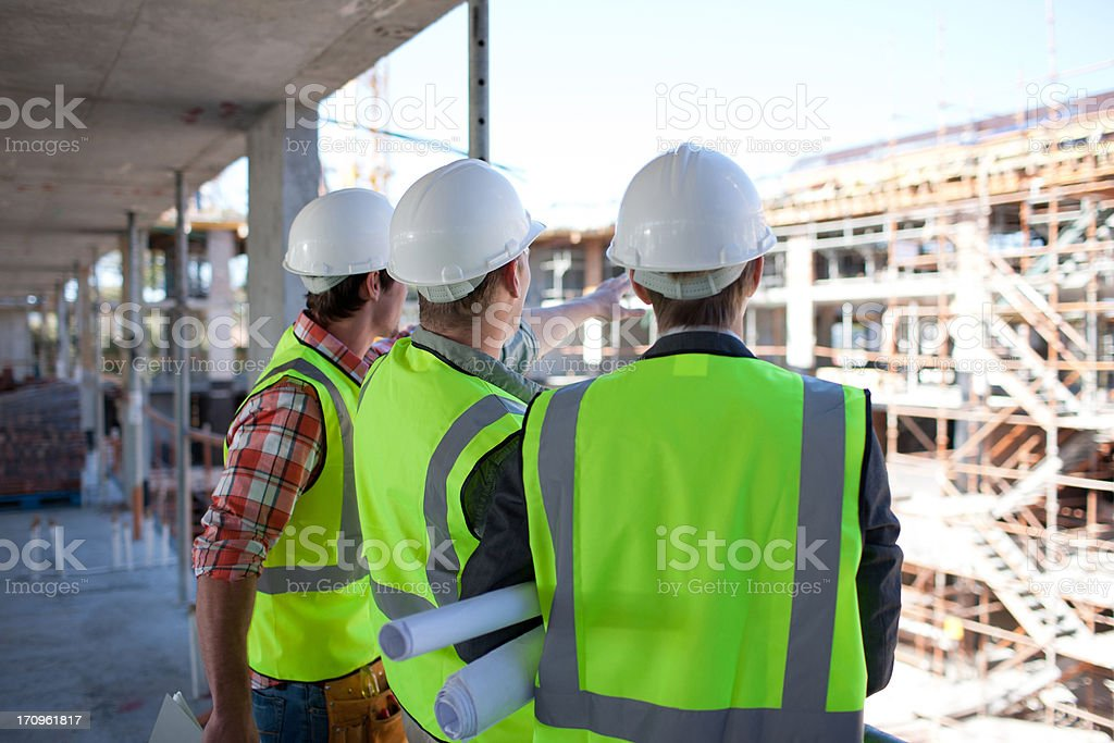 Construction workers talking on construction site stock photo