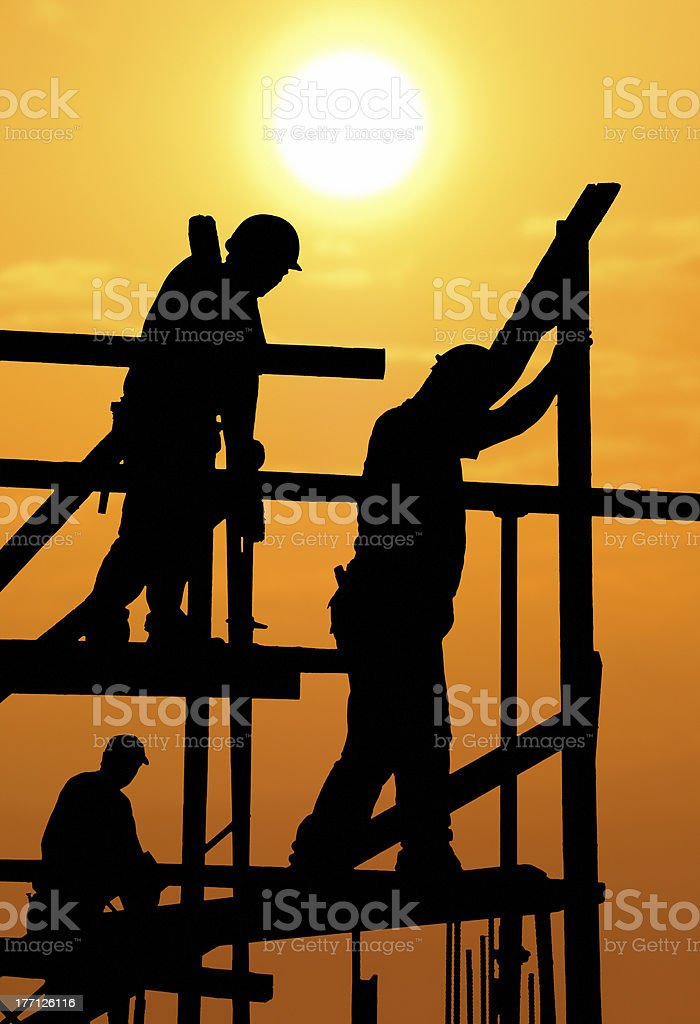Construction workers under a hot blazing sun stock photo