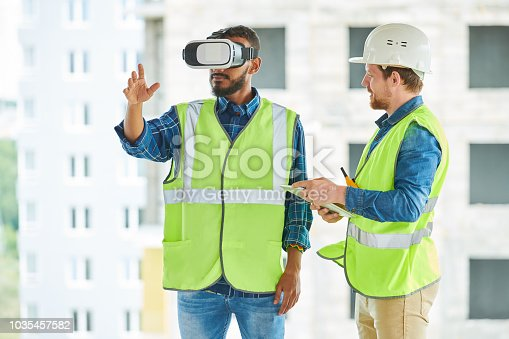 534196421istockphoto Construction Workers Using Visual Simulator on Site 1035457582