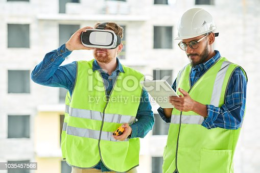 534196421istockphoto Construction Workers Using VR on Site 1035457566