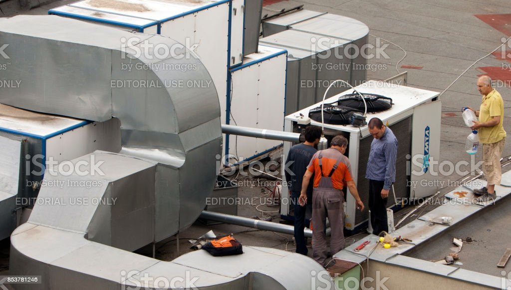 Construction workers ventilation and air conditioning systems stock photo