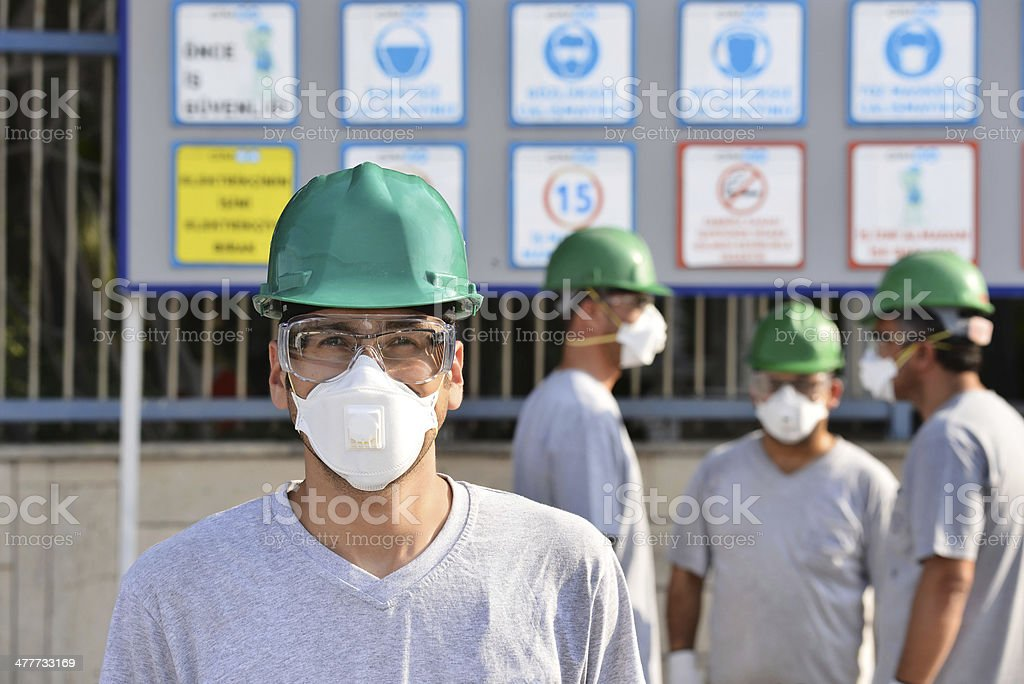 Construction workers with masks stock photo
