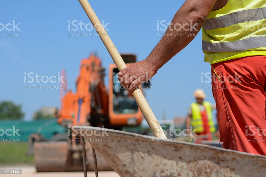 Construction workers with shovelin his hand stock photo