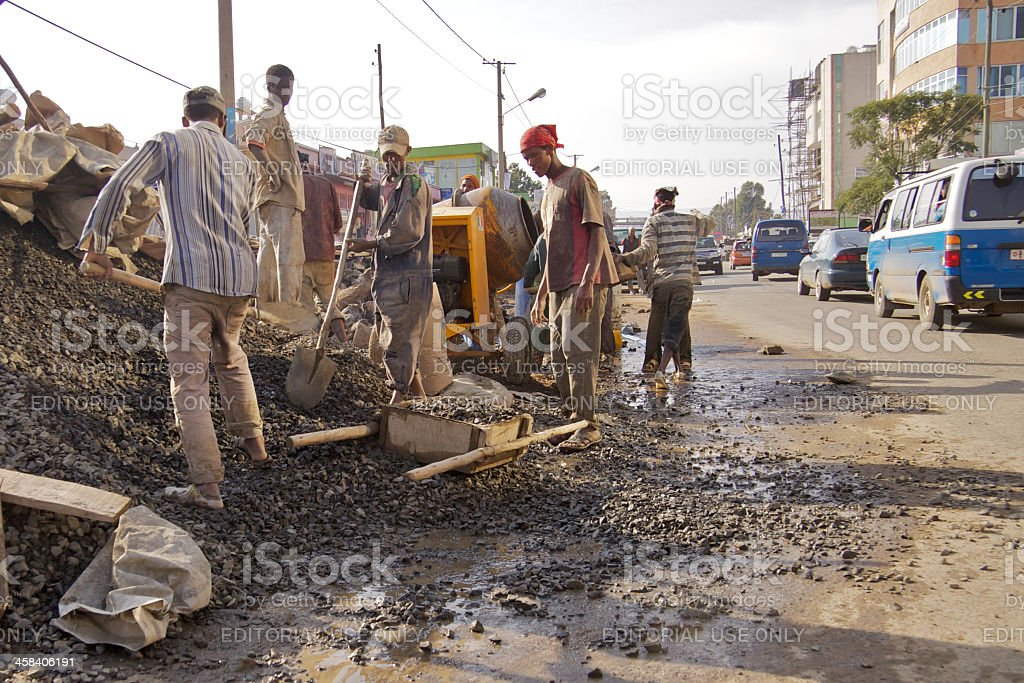 Construction workers working at the street royalty-free stock photo