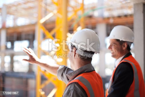 istock Construction workers working on construction site 170961867