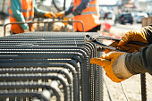 istock construction workers working site with pincers 1258020113
