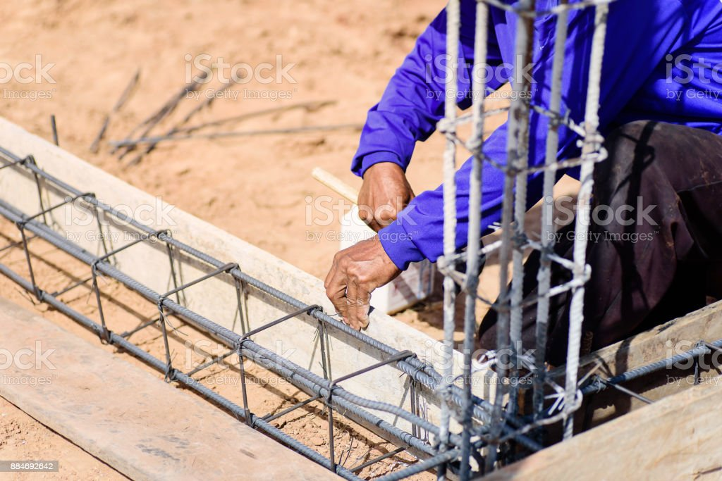 Construction work,the worker making formwork at construction site stock photo