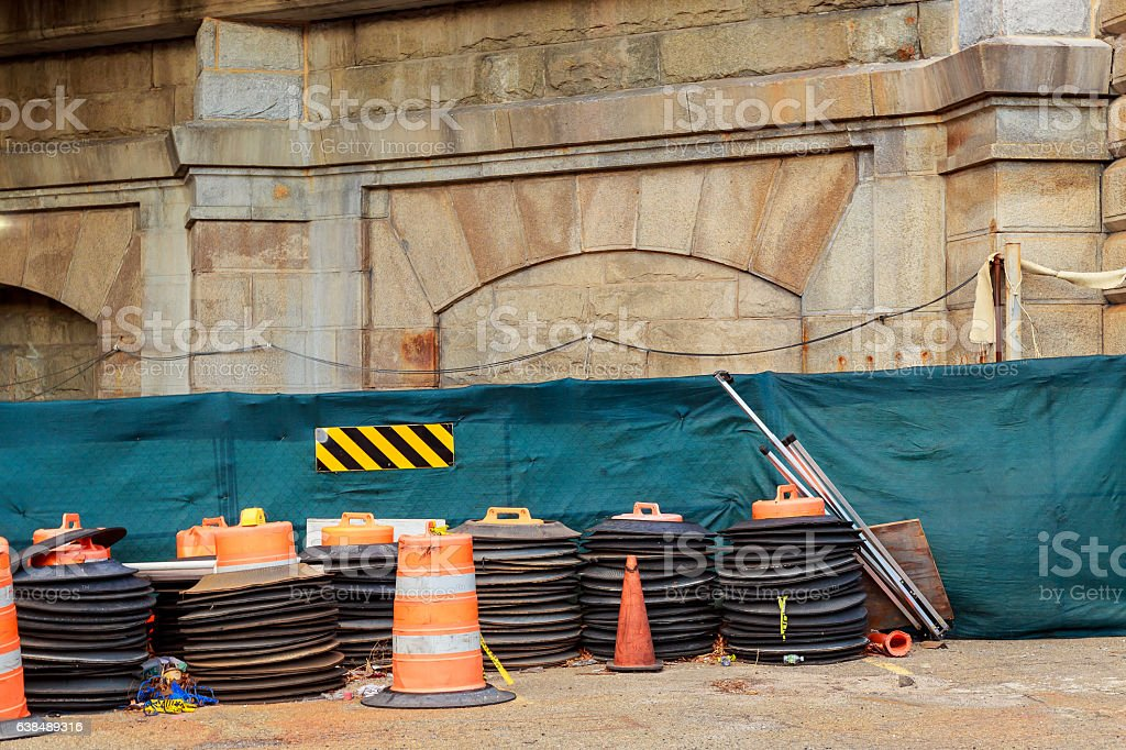 Construction zone with orange caution markers along an urban street. stock photo