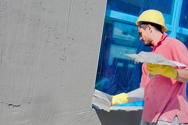 Construction:Stucco contractor stock photo