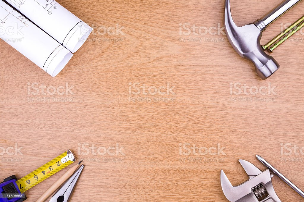 construction:work tool and blueprint on wood royalty-free stock photo