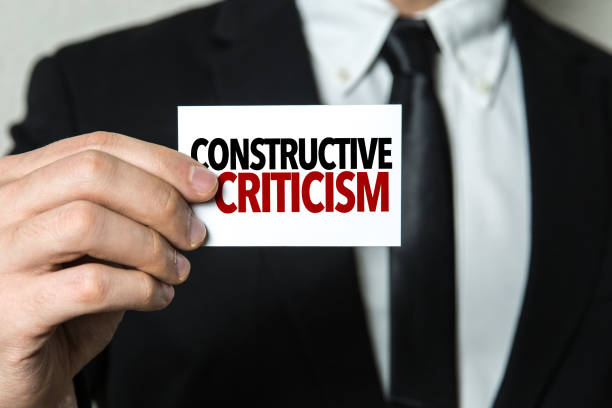 Constructive Criticism Constructive Criticism sign scolding stock pictures, royalty-free photos & images