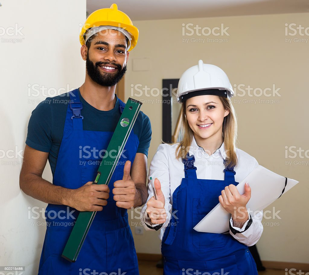 Constructor and builder with spirit level at site stock photo
