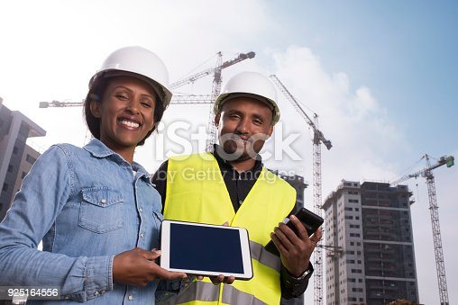 994878714 istock photo Constructor engineer couple showing blank tablet PC. 925164556