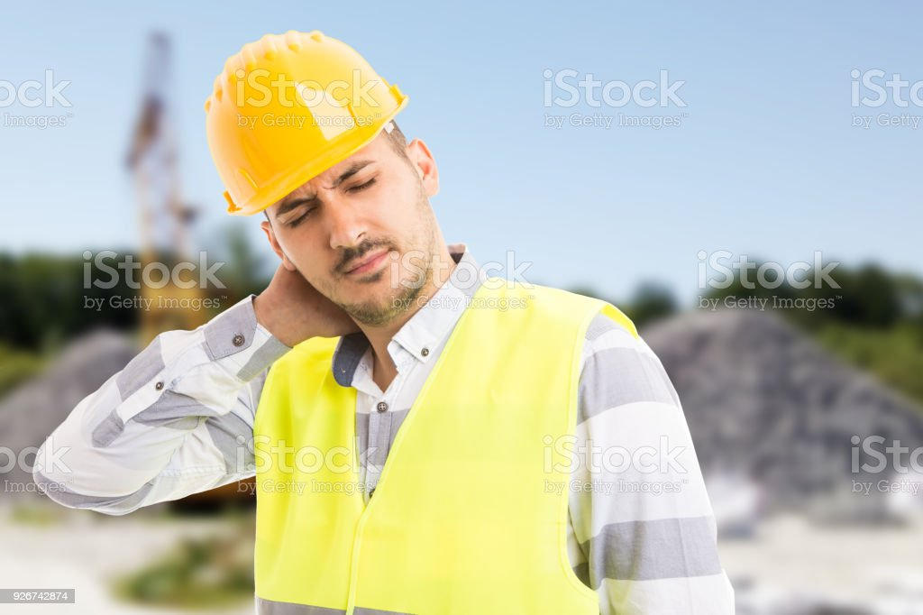 Constructor or builder suffering scruff pain stock photo
