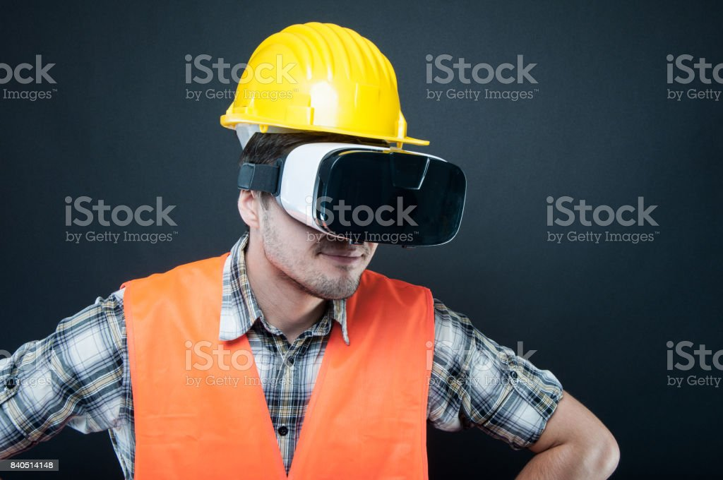 Constructor portrait wearing virtual reality goggles stock photo
