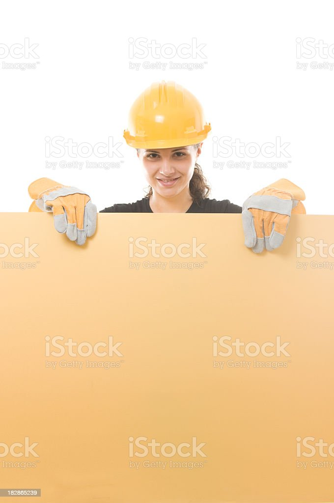 Constructor woman holding an empty board royalty-free stock photo