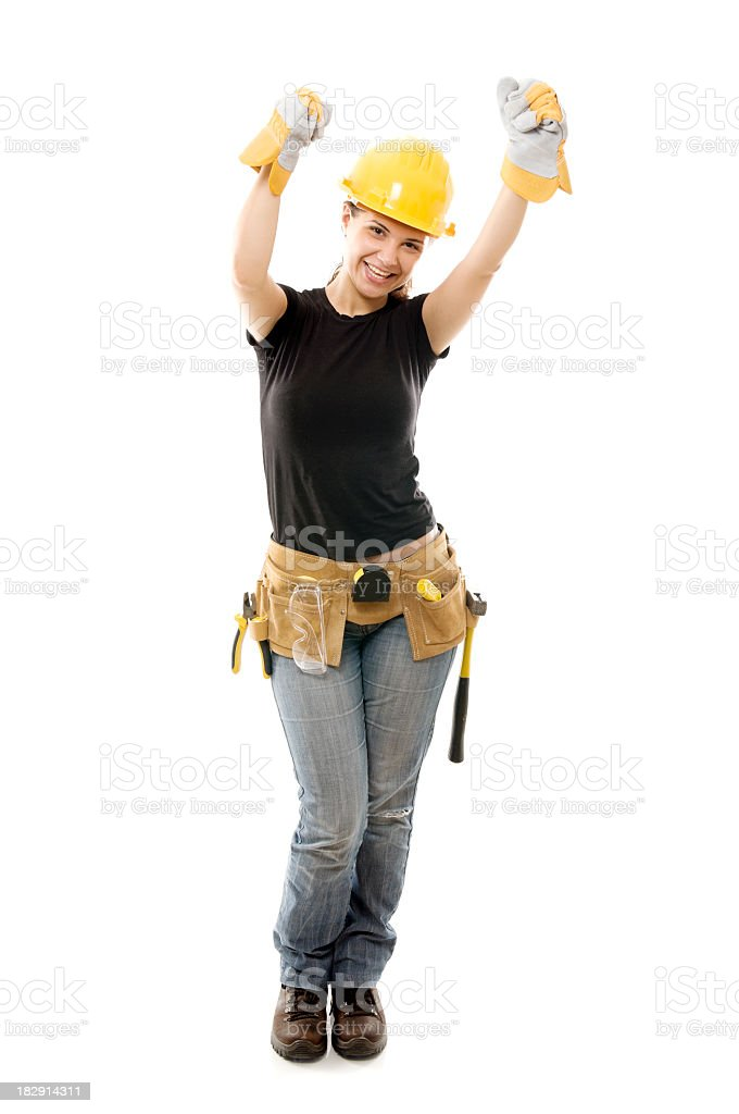 Constructor woman with arms raised, happy, isolated on white stock photo