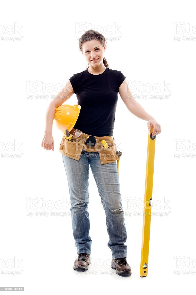 Constructor woman with level, isolated on white stock photo