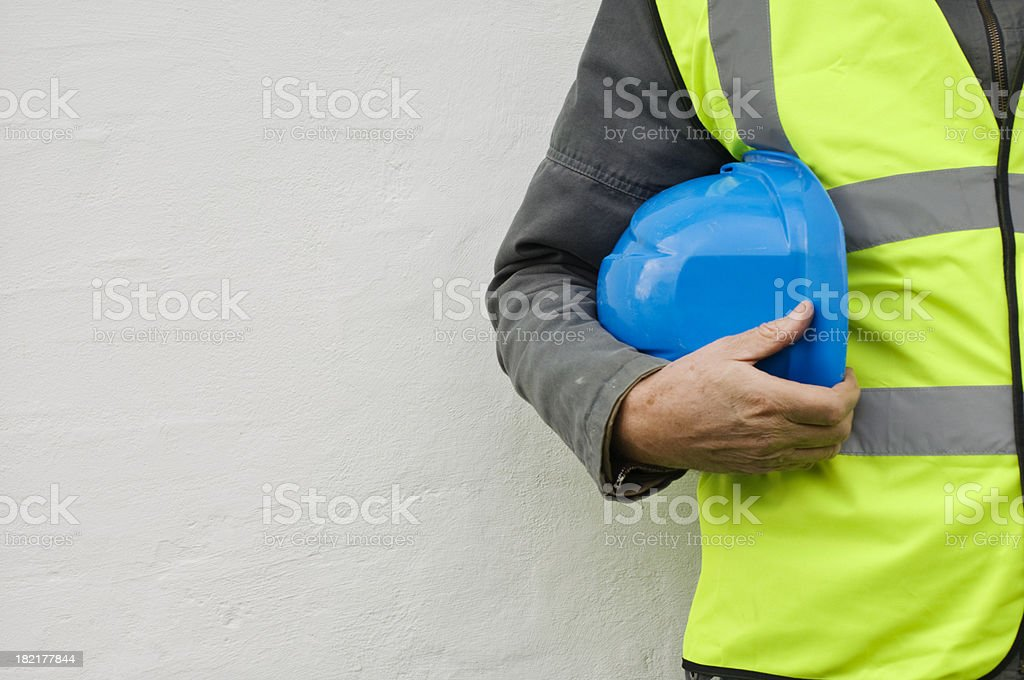 Constuction Worker With Hi-Visibilty Safety Jacket and Hard Hat. stock photo