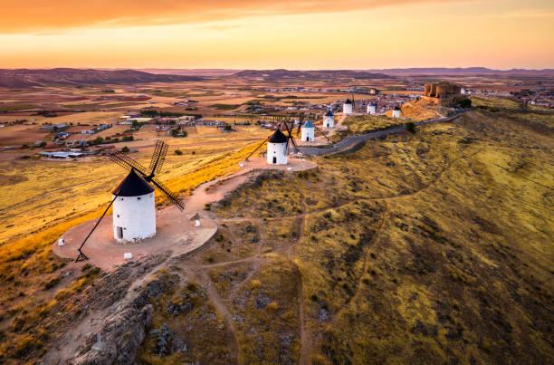 Consuegra windmills at sunset. Castilla La Mancha, Spain stock photo