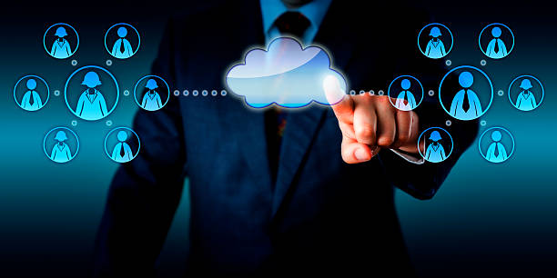 Consultant Connecting Two Work Teams Via Cloud stock photo