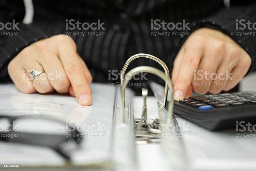 consultant is searching for irregularities in the documentation stock photo