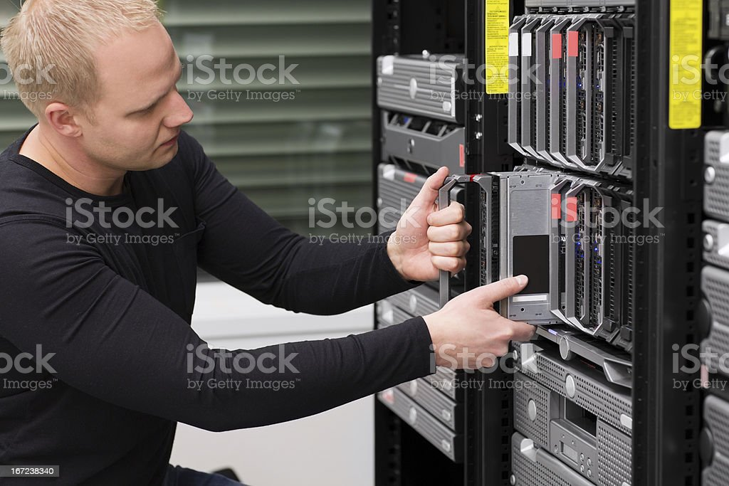 IT Consultant Maintain Blade Server in Datacenter royalty-free stock photo