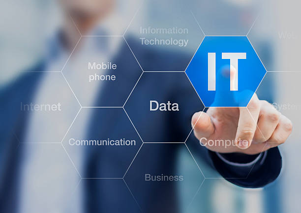 IT consultant presenting tag cloud about information technology stock photo