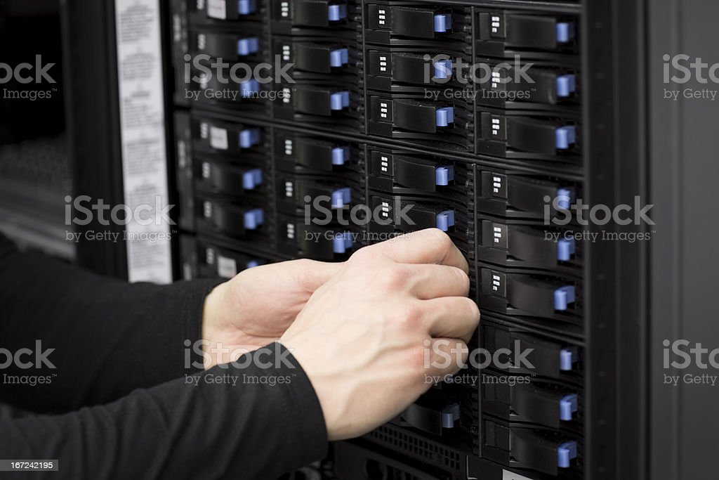 IT Consultant Replace Hard Drive in SAN royalty-free stock photo