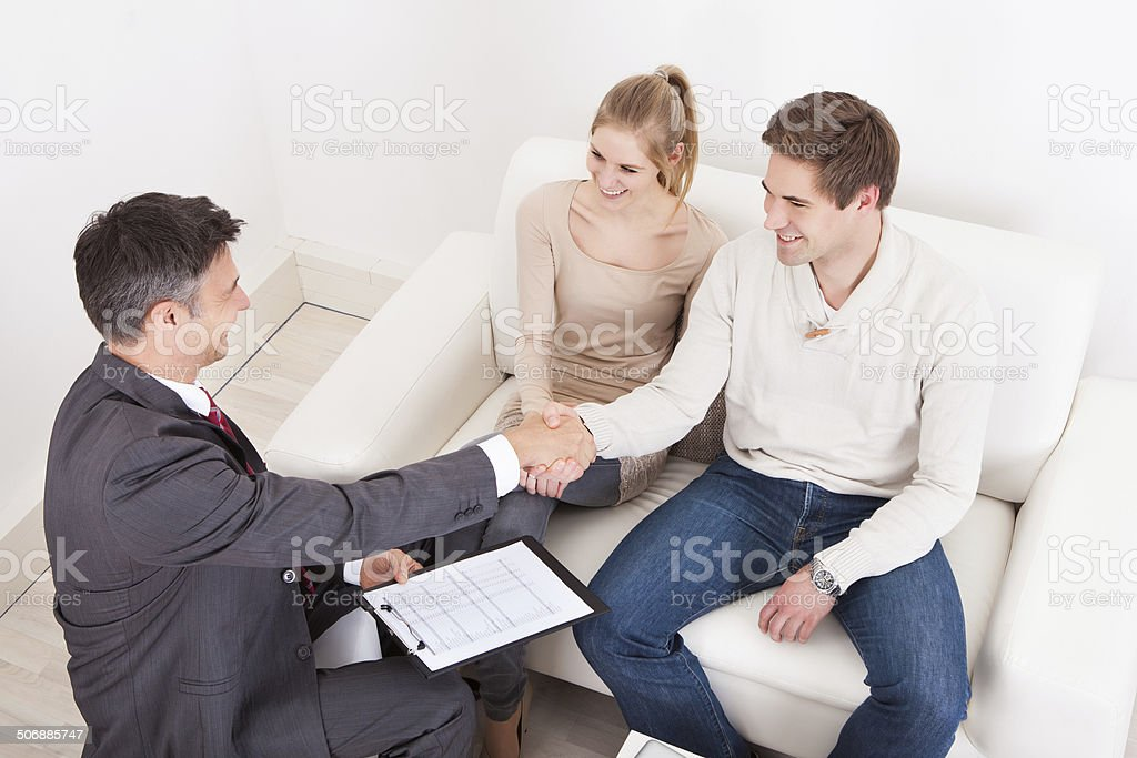 Consultant Shaking Hand With Customer stock photo
