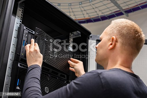 istock IT Consultant Working With Servers In Large Enterprise Datacenter 1148690561