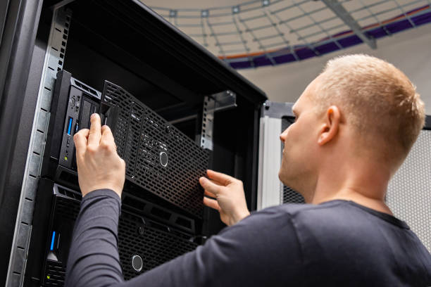 IT Consultant Working With Servers In Large Enterprise Datacenter stock photo