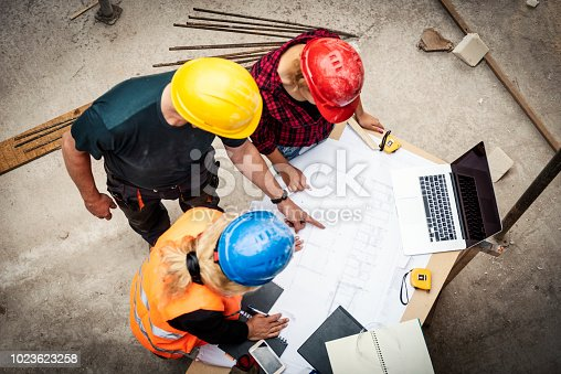521012560istockphoto Consultation about blueprints 1023623258