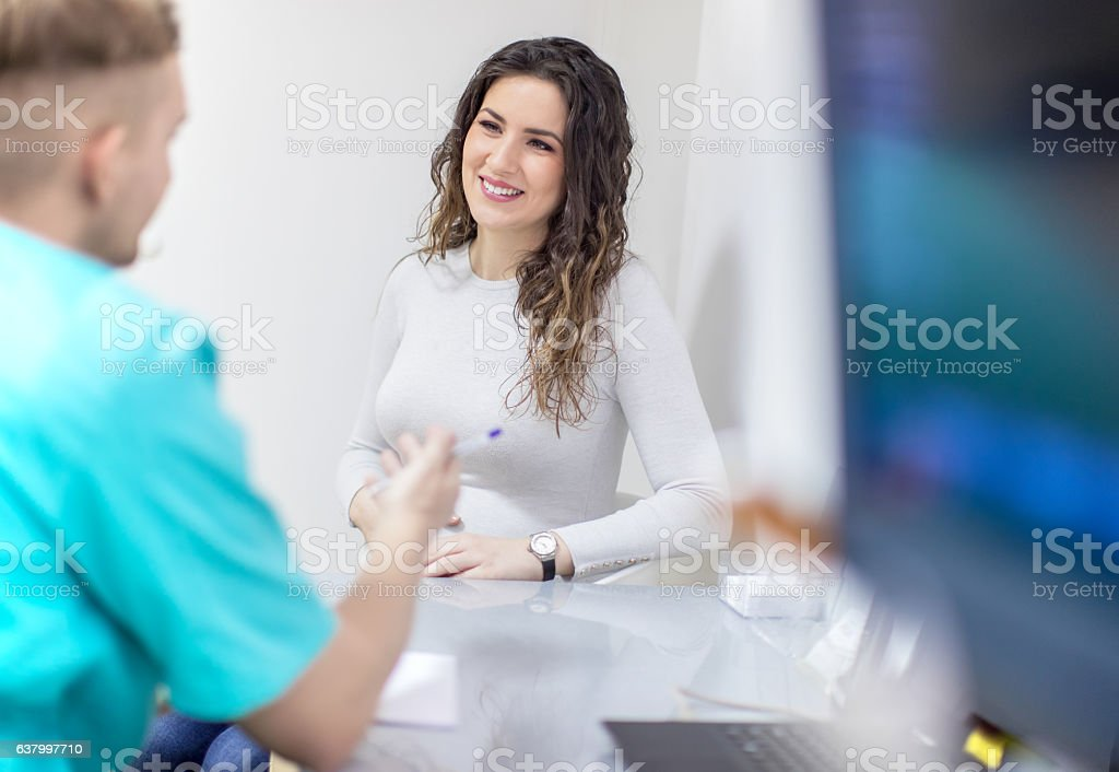 Consultation in doctor's office stock photo