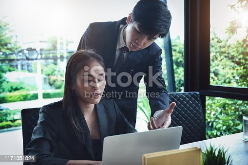 927401824 istock photo Consultation or Market data research concept, Adjustment of marketing strategies Female company owner discussing to a male market analyst To consult the company's marketing strategy. 1171351824