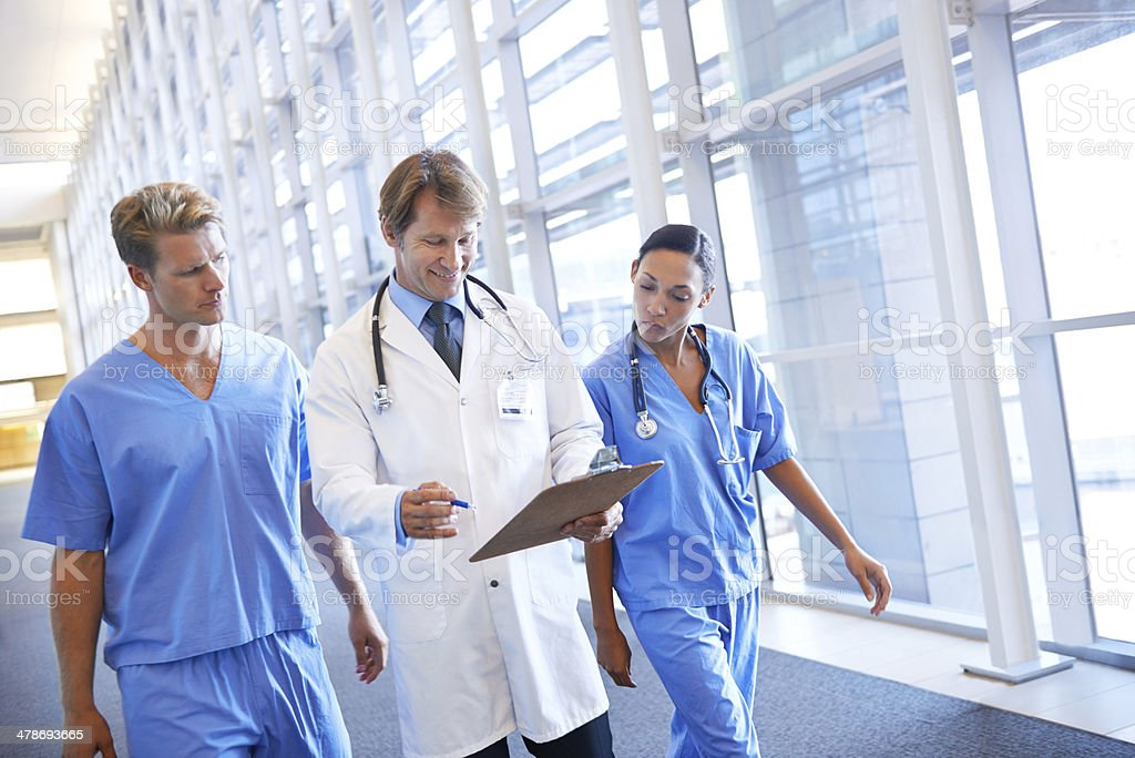 Consulting his medical colleagues stock photo