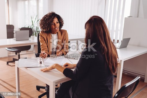 Financial consultant manager talking with a female client at the bank