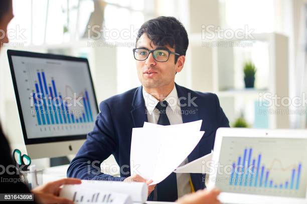 Consulting With Colleague Stock Photo - Download Image Now